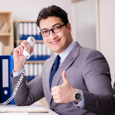 Man completing a successful sales call